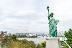 Lady liberty juxtaposed against Rainbow Bridge in Tokyo. Royalty Free Stock Photo