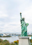 Lady liberty juxtaposed against Rainbow Bridge in Tokyo. Stock Photos
