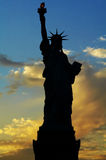 Lady Liberty silhouette. Liberty statue silhouette at dusk Royalty Free Stock Photos