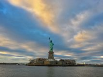 Lady Liberty stands among a dramatic landscape stock photography
