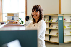 Lady in library Royalty Free Stock Image