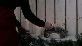 A lady lights candles. The warmth and atmosphere of the Xmas holiday. Xmas Decoration. Christmas and Happy New Year.  stock footage