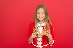 Lady little princess. Girl cute smile hold crown while stand red background. Best award for me. Kid hold golden crown. Symbol of princess. Happy childhood royalty free stock image