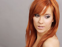 Lady With Long Red Hair. Portrait of a beautiful young woman with long red hair and beautiful eyes Royalty Free Stock Images