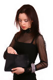 Lady looking in her handbag. Lady in black dress looking in her handbag Stock Images