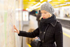 Lady looking on public transport map panel. Stock Image