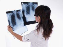 Lady looking at x-ray Royalty Free Stock Image