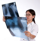 Lady looking at x-ray Stock Photography