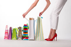 Lady looks the purchases. Royalty Free Stock Images
