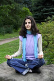 Lady in lotus position yoga royalty free stock photos
