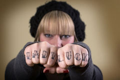 Lady luck tattoo on knuckles Stock Photo
