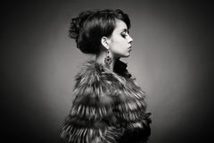 Lady in luxurious fur coat Stock Photography