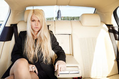 Lady in a luxury car Royalty Free Stock Photo