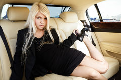 Lady in a luxury car royalty free stock photography