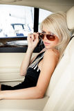 Lady in a luxury car Stock Photos