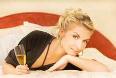 Lady lying in a bed Royalty Free Stock Images