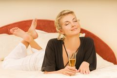 Lady lying in a bed Stock Image