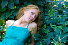 Lady lying on grass Stock Photography