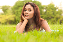 Lady lying on grass Stock Photos