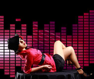 Lady, lying on the table, on disco  background Royalty Free Stock Photo