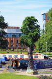 Lady Macbeth and Royal Shakespeare Theatre. Royal Shakespeare Theatre with narrowboats and Lady Macbeth statue in the foreground, Stratford-upon-Avon Royalty Free Stock Photos
