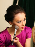 Lady with makeup. Stylish woman applying makeup with brush Royalty Free Stock Images