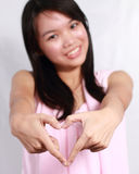 Lady making heart shape with hands stock photos