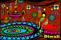 Lady making Rangoli for Diwali Stock Images