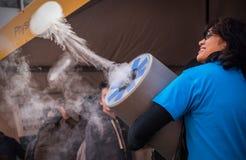 Lady making smoke puff Stock Images