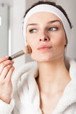 Lady making up Stock Image