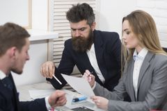 Lady manager tries to organize working process with colleagues in office. Business colleagues at meeting, office. Background. Office atmosphere concept royalty free stock image