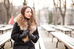Lady manager. Young professional lady in the park is enjoying winter Royalty Free Stock Photo