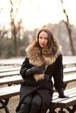 Lady manager. Young professional lady in the park is enjoying winter Stock Photos