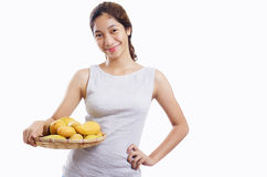 Lady With Mangoes Stock Image