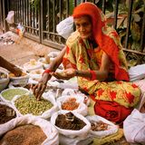 Lady in the market. Seller of spicies stock photography