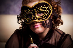 Lady mask. Beautiful woman hides her face behind the carnival mask Stock Image