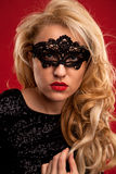 Lady in mask. Beautiful lady in mask with red lips black and white portrait Stock Photography