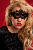 Lady in mask. Beautiful lady in mask with red lips black and white portrait Stock Image