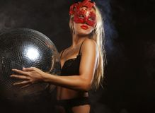 Lady in mask with disco ball. Young lady in mask with disco ball Stock Photography