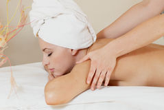 Lady in massage salon Stock Image