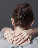 Lady massaging her shoulders and head Royalty Free Stock Photo