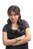 Lady with a mean smile. Pretty asian lady with a mean smile royalty free stock photo