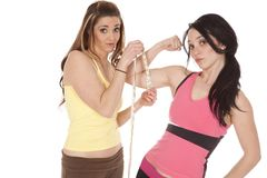 Lady measuring anothers arm Stock Image