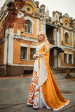 Lady in medieval costume. Beautiful lady with blond hairs in medieval dress royalty free stock photo