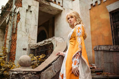 Lady in medieval costume. Beautiful lady with blond hairs in medieval dress stock image