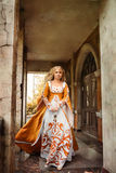 Lady in medieval costume. Beautiful lady with blond hairs in medieval dress Royalty Free Stock Images