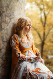 Lady in medieval costume. Beautiful lady with blond hairs in medieval dress stock photos