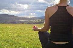 Lady Meditating on Field Stock Photography