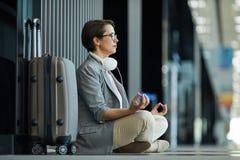 Lady meditating before flight stock photo