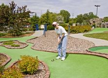 Lady At Mini Golf Course Stock Photo